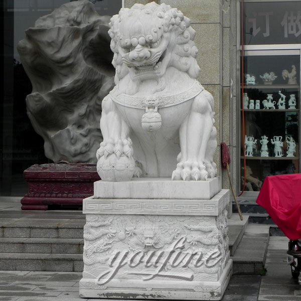 Asian foo dog stone lion statues pair in front of house